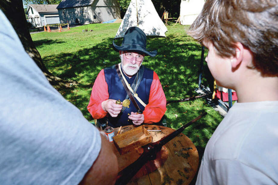 Author and histrian Blaikie Hines demonstrates how to make ammunition during the Rowayton Historical Society sponsored Civil War encampment at Pinkney Park Saturday where kids 6 and up to had the opportunity to be a trained like a union soldier as well as experience, music, a Civil War exhibit, and have a visit from Abe Lincoln and other historic characters.Hour photo / Erik Trautmann / (C)2012, The Hour Newspapers, all rights reserved