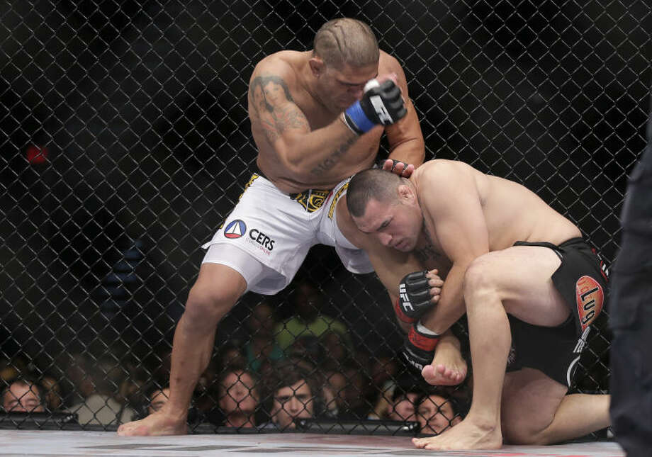 Cain Velasquez, right, tries to take down Antonio Silva in the first round of the UFC 160 mixed martial arts heavyweight title bout, Saturday, May 25, 2013, in Las Vegas. Velasquez won by technical knockout in the first round. (AP Photo/Julie Jacobson)