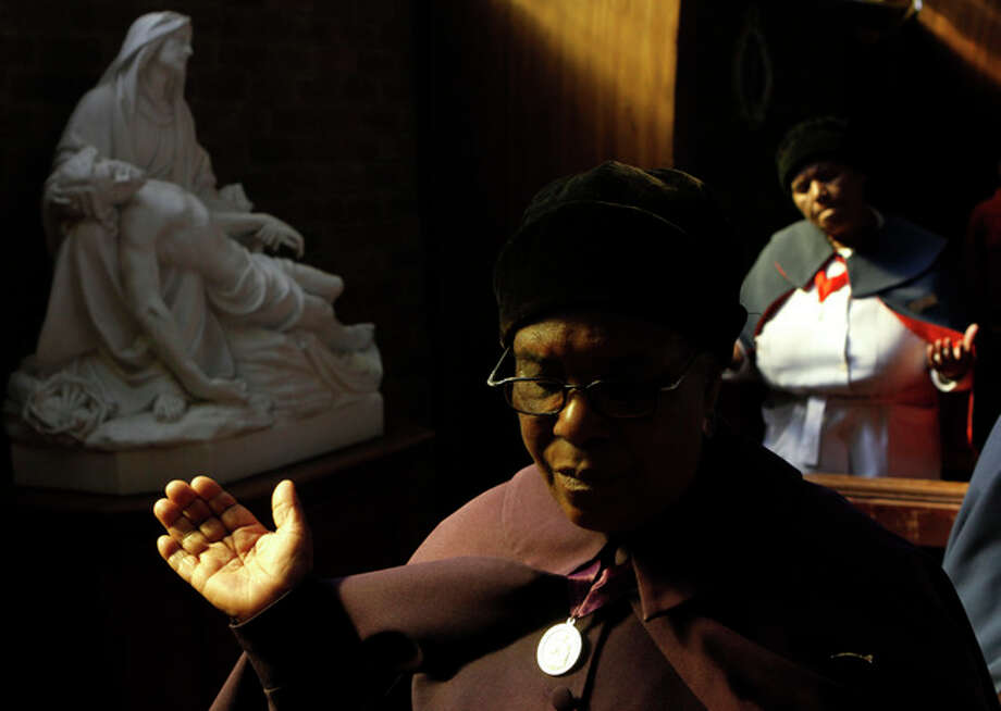 Worshippers attend morning mass at the Regina Mundi Catholic Church in Soweto, South Africa , Sunday June 9, 2013. Churchgoers were urged to pray for former president Nelson Mandela who has been hospitalized with an occurring lung infection. The latest government report says that Mandela remains in a serious but stable condition. (AP Photo/Denis Farrell) / AP