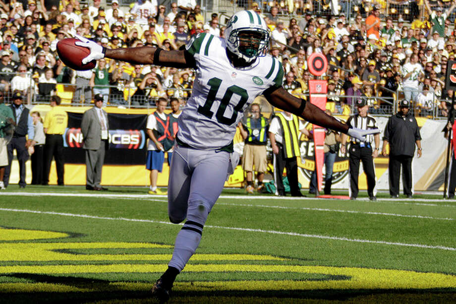 New York Jets wide receiver Santonio Holmes (10) celebrates as he runs through the end zone after catching a pass for touchdown in the first quarter of an NFL football game against the Pittsburgh Steelers in Pittsburgh, Sunday, Sept. 16, 2012. (AP Photo/Gene J. Puskar) / AP