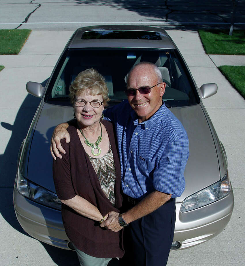 In this photo taken Sept. 12, 2012, Sandy and Jerry Wiseman pose in the driveway with one of their two cars , in Schaumburg, Ill. Jerry Wiseman and his wife, Sandy, took refresher driving classes to help them stay safe behind the wheel for many more years. More older drivers are on the road, and they face a hodgepodge of state licensing rules that reflect scientific uncertainty and public angst over a growing question: How can we tell if it's time to give up the keys? (AP Photo/Charles Rex Arbogast) / AP