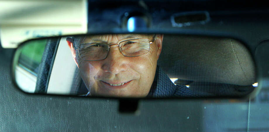In this photo taken Sept. 12, 2012, Jerry Wiseman is reflected in the rearview mirror, in Schaumburg, Ill. Jerry Wiseman and his wife, Sandy, took refresher driving classes to help them stay safe behind the wheel for many more years. More older drivers are on the road, and they face a hodgepodge of state licensing rules that reflect scientific uncertainty and public angst over a growing question: How can we tell if it's time to give up the keys? (AP Photo/Charles Rex Arbogast) / AP