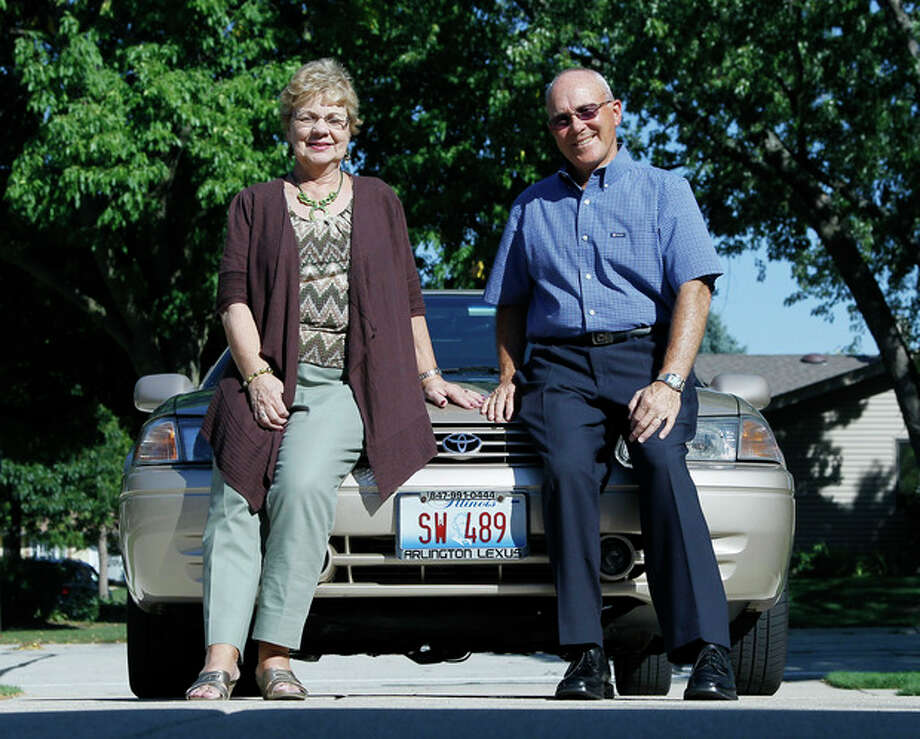 In this photo taken Sept. 12, 2012, Sandy and Jerry Wiseman pose in the driveway with one of their two cars, in Schaumburg, Ill. Jerry Wiseman and his wife, Sandy, took refresher driving classes to help them stay safe behind the wheel for many more years. More older drivers are on the road, and they face a hodgepodge of state licensing rules that reflect scientific uncertainty and public angst over a growing question: How can we tell if it's time to give up the keys? (AP Photo/Charles Rex Arbogast) / AP