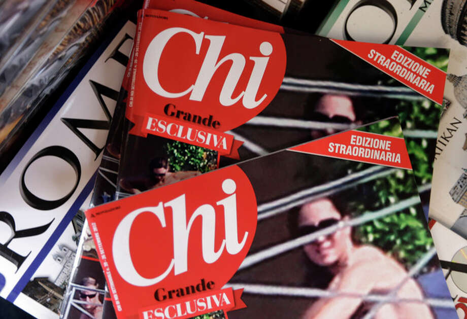 Copies of the Italian magazine Chi are displayed at a newstands in Rome, Monday, Sept. 17, 2012. An Italian gossip magazine owned by former Premier Silvio Berlusconi published a 26-page spread of topless photos of Prince William's wife Kate on Monday despite legal action in France against the French magazine that published them first. Chi hit newsstands on Monday, featuring a montage of photos taken while the Duke and Duchess of Cambridge were on vacation at a relative's home in the south of France last month. They included the 14 pictures published by the popular French magazine Closer, which like Chi is owned by Berlusconi's Mondadori publishing house. (AP Photo/Alessandra Tarantino) / AP