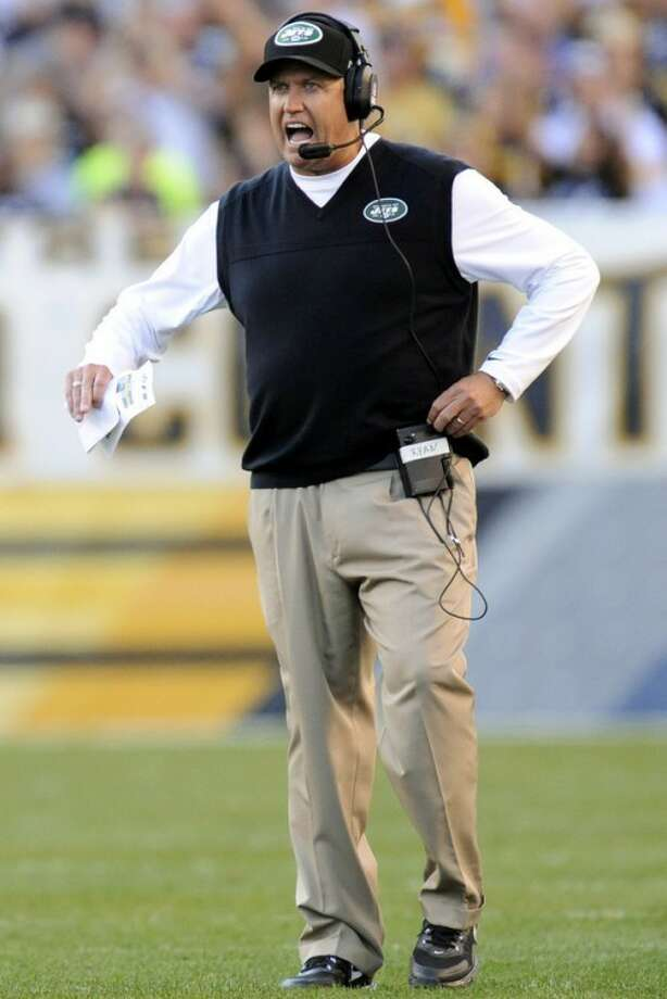 New York Jets head coach Rex Ryan walks out on the turf at Heinz Field as a touchdown by the Pittsburgh Steelers is reviewed in the third quarter of an NFL football game, Sunday, Sept. 16, 2012, in Pittsburgh. The Steelers won 27-10. (AP Photo/Don Wright)