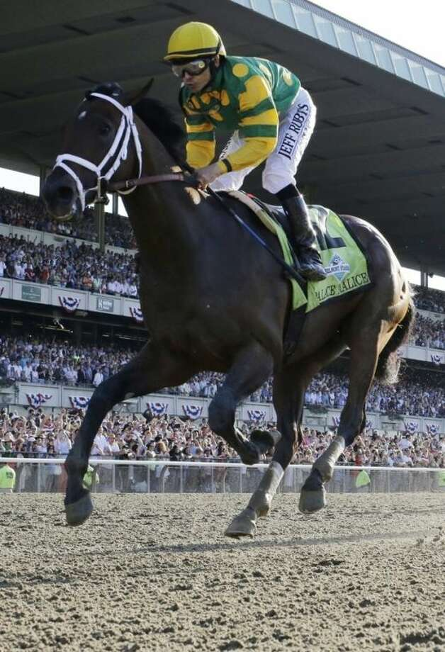 Palace Malice, ridden by jockey Mike Smith, crosses the finish line to win the 145th Belmont Stakes horse race at Belmont Park Saturday, June 8, 2013, in Elmont, N.Y. (AP Photo/Julio Cortez)