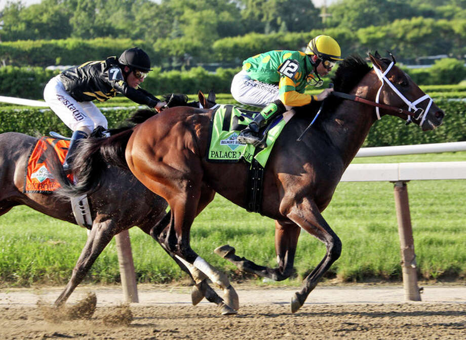 Palace Malice , right, ridden by jockey Mike Smith, battles Oxbow, with jockey Gary Stevens up, around the fourth turn in the Belmont Stakes horse race in Elmont, N.Y., Saturday, June 8, 2013. Palace Malice won the race, Oxbow finished second. (AP Photo/Peter Morgan) / AP