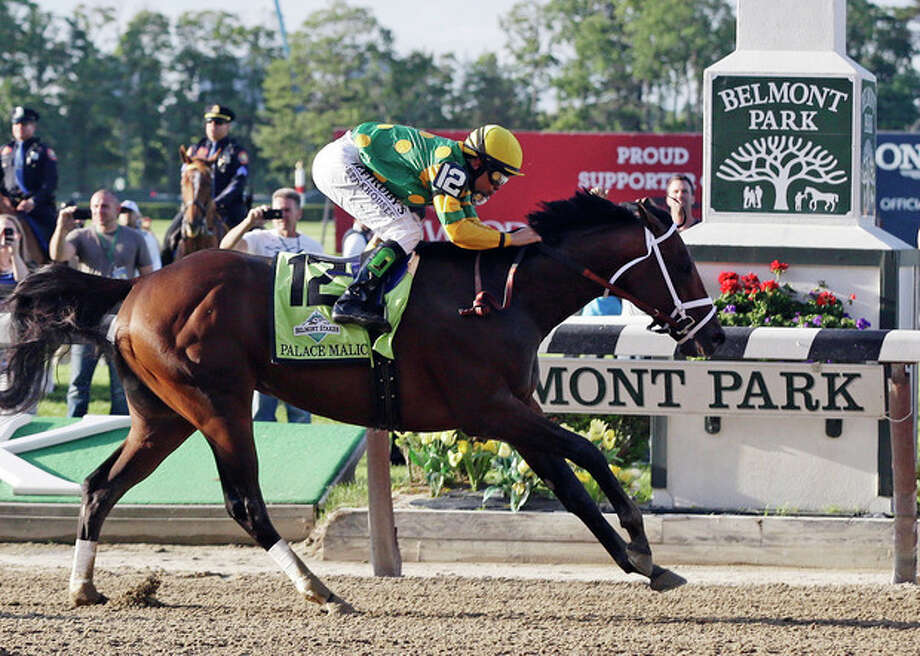 Palace Malice, ridden by jockey Mike Smith, crosses the finish line to win the the 145th Belmont Stakes horse race at Belmont Park Saturday, June 8, 2013, in Elmont, N.Y. (AP Photo/Frank Franklin II) / AP