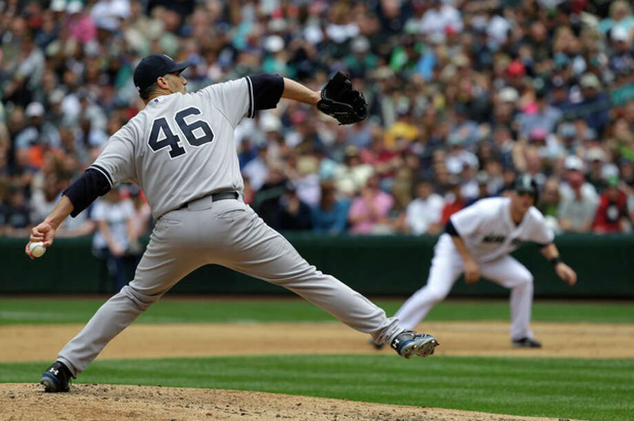New York Yankees starting pitcher Andy Pettitte (46) throws in the fourth inning of a baseball game against the Seattle Mariners, Saturday, June 8, 2013, in Seattle. (AP Photo/Ted S. Warren) / AP