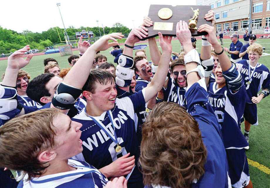 Hour photo/Erik TrautmannThe Wilton boys lacrosse team celebrates in its win in the Class M championship game against Joel Barlow Saturday at Brien McMahon High School. The 17th-seeded Warriors completed their Cinderella run to the championship with a 9-6 win over the Falcons. Along the way the whipped top-seeded Avon and also beat highly regarded Darien and New Fairfield. / (C)2013, The Hour Newspapers, all rights reserved