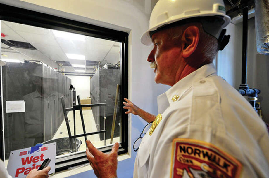 Norwalk Fire Chief Denis McCarthy talks about the city's new server room while taking The Hour on a tour of the new Fire Headquarters. / (C)2013, The Hour Newspapers, all rights reserved