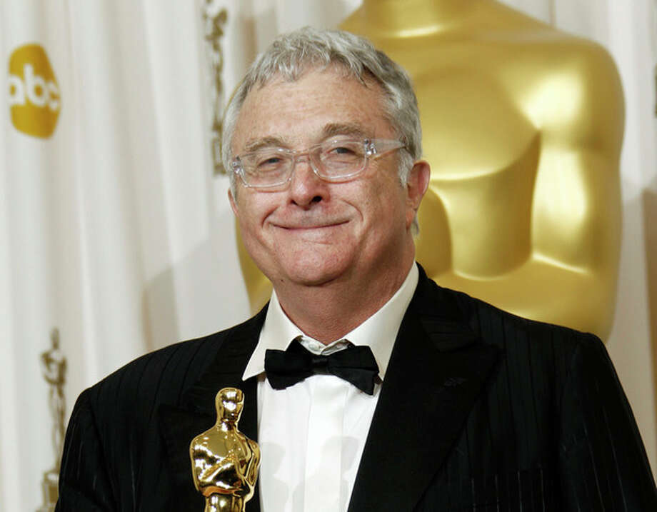 "FILE - This Feb. 27, 2011 file photo shows composer Randy Newman posing backstage with the Oscar for best original song for ""We Belong Together"" from ""Toy Story 3"" at the 83rd Academy Awards in the Hollywood section of Los Angeles. Newman is weighing in on the presidential election, and he's playing the race card through a song he wrote. I'm Dreaming"" is full of satirical, sarcastic _ and signature Newman _ anecdotes about someone who votes for the president because he is white. It features the refrain: ""I'm dreaming of a white president."" Newman is openly supporting President Barack Obama. He says though the song is serious, he wants the public to find comedic relief in it.(AP Photo/Matt Sayles, File) / AP"