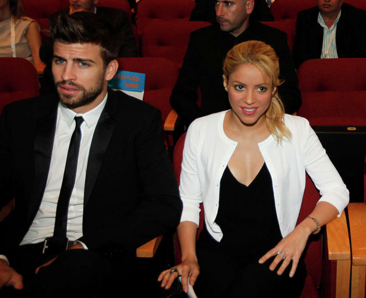 """FILE - This June 21, 2011 file photo shows Colombian singer Shakira with her boyfriend FC Barcelona Gerard Pique, left, during a plenary session at the President's Conference in Jerusalem. Shakira promoted her global education campaign with a stop at a joint Israeli-Arab school in Jerusalem on. Shakira is pregnant with her first child. The 35-year-old posted on her website Wednesday that she and boyfriend Gerard Pique ?""""are very happy awaiting the arrival of our first baby.?"""" Pique, who is from Barcelona, is a soccer player for FC Barcelona. (AP Photo/Tara Todras-Whitehill, Pool)"""