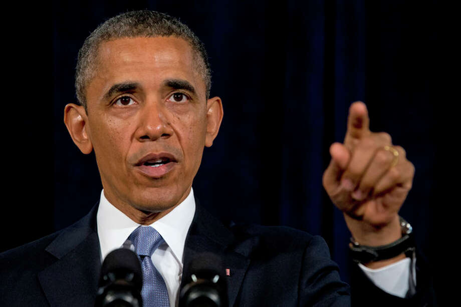 President Barack Obama gestures while speaking in San Jose, Calif. , Friday, June 7, 2013. The president defended his government's secret surveillance, saying Congress has repeatedly authorized the collection of America's phone records and U.S. internet use. (AP Photo/Evan Vucci) / AP