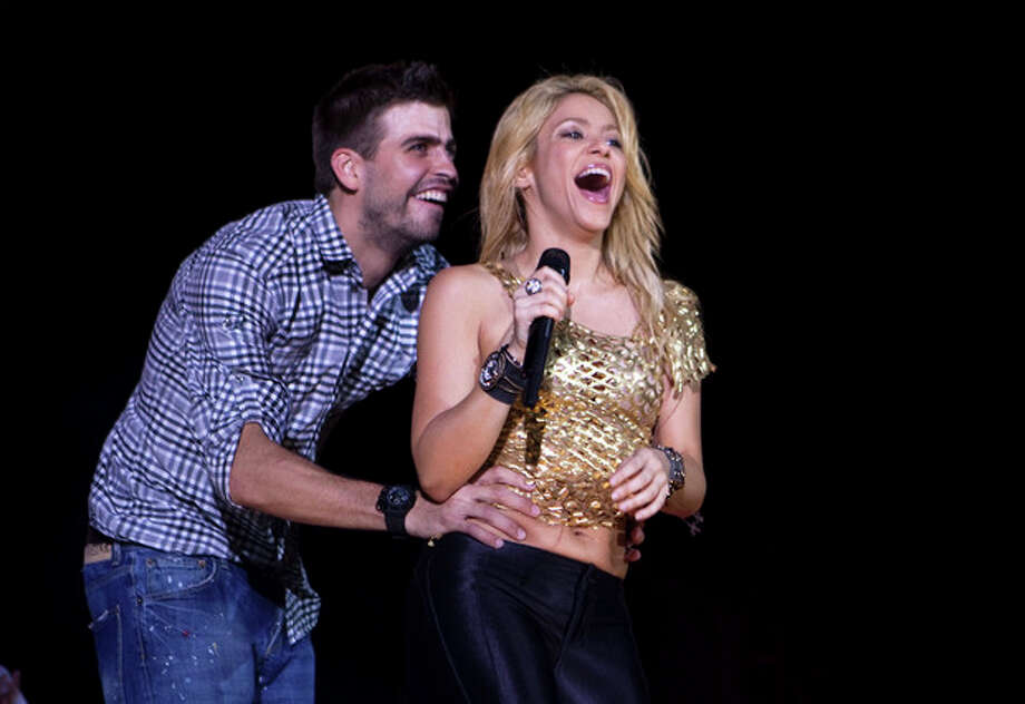 "FILE - This May 29, 2011 file photo shows Colombia's singer Shakira performs with FC Barcelona Gerard Pique during The Sun Comes Out World Tour concert in Barcelona, Spain. Shakira is pregnant with her first child. The 35-year-old posted on her website Wednesday that she and boyfriend Gerard Pique ""are very happy awaiting the arrival of our first baby."" Pique, who is from Barcelona, is a soccer player for FC Barcelona. (AP Photo/Emilio Morenatti, file) / AP"