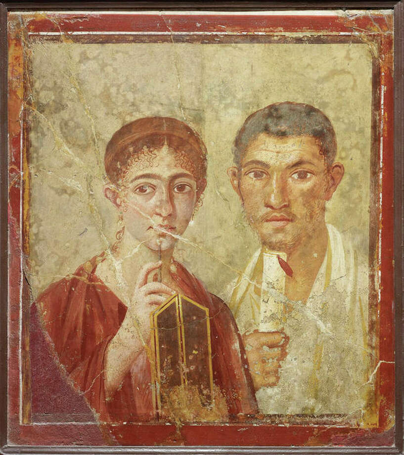Undated handout photo issued by the British Musuem Thursday Sept. 20, 2012 of a wall painting of the baker Terentius Neo and his wife, from the House of Terentius Neo, Pompeii, AD 50-79. as dozens of objects recovered from the ruins of Roman cities Pompeii and Herculaneum will go on show outside Italy for the first time at a new exhibition at the museum. The two cities on the Bay of Naples were wiped out by the eruption of Mount Vesuvius in 79 AD. The show will feature objects found in their ruins including jewellery, carbonised food and a baby's crib that still rocks on its curved runners. The exhibition will run March 28 to Sept. 29, 2013. (AP Photo/The Trustees of the British Museum) / British Museum