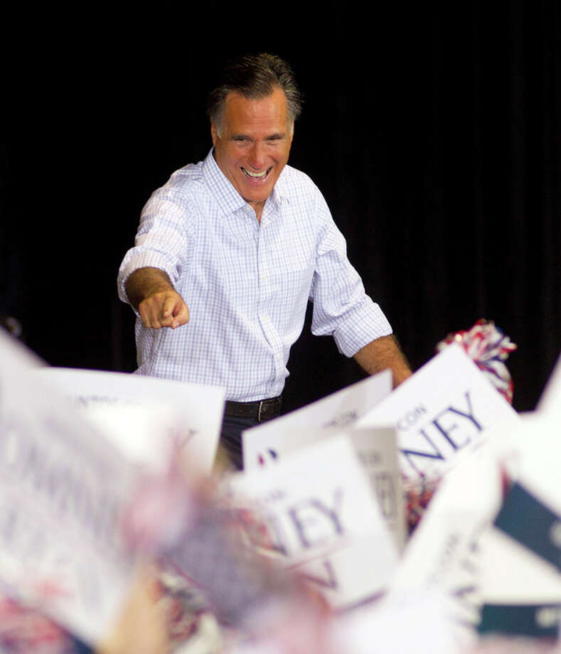 Republican presidential candidate and former Massachusetts Gov. Mitt Romney waves to supporters before he makes a speech in Miami, Wednesday, Sept. 19, 2012. (AP Photo/J Pat Carter) / AP