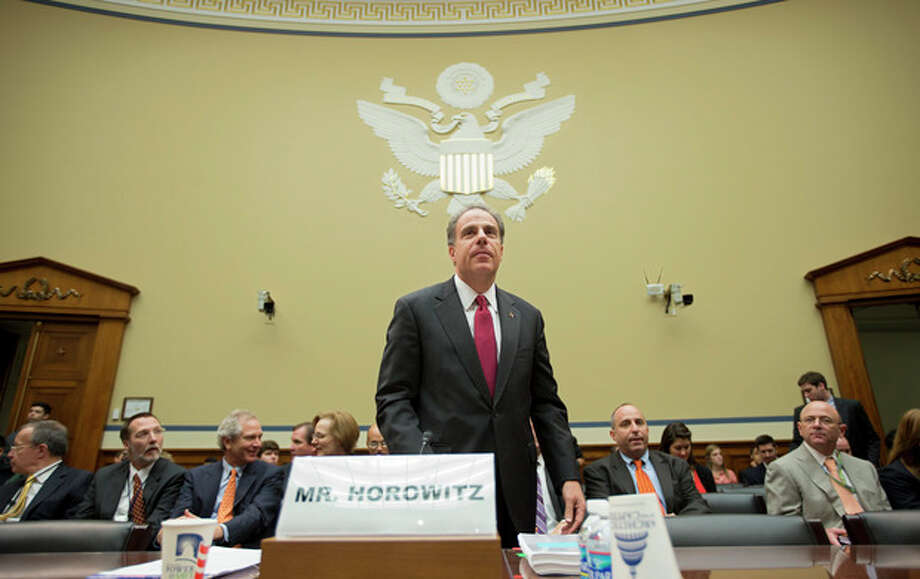 """Michael Horowitz, the Justice Department's inspector general, arrives to testify before the House Oversight and Government Reform Committee a day after he faulted the department for disregard of public safety in """"Operation Fast and Furious,"""" the Bureau of Alcohol, Tobacco, Firearms and Explosives' program that allowed hundreds of guns to reach Mexican drug gangs, on Capitol Hill in Washington, Thursday, Sept. 20, 2012. While the IG's report confirmed findings by Congress' investigation of misguided strategies, errors in judgment and management failures in """"Fast and Furious"""", it did not find direct fault with Attorney General Eric Holder, who had been directly targeted by Rep. Darrell Issa, R-Calif., the committee's chairman. (AP Photo/J. Scott Applewhite) / AP"""