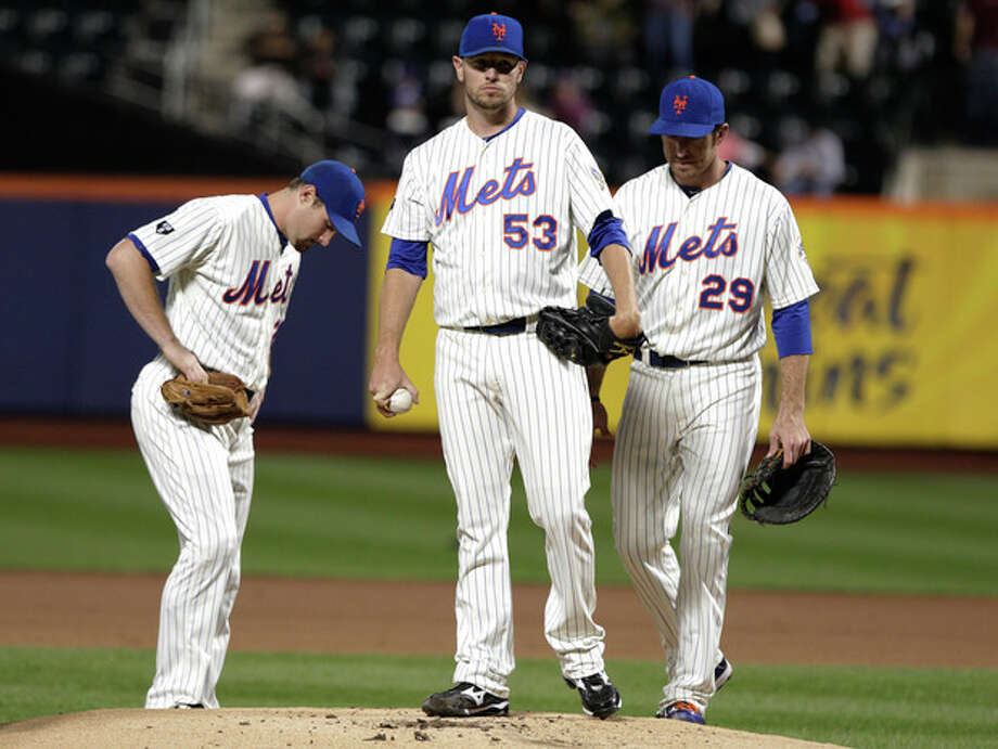 REMOVES REFERENCE TO RELIEF PITCHER - New York Mets pitcher Jeremy Hefner waits to be taken out of the baseball game against the Philadelphia Phillies during the first inning, Thursday, Sept. 20, 2012, in New York. (AP Photo/Frank Franklin II) / AP