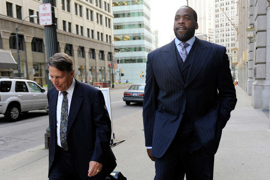 In a Sept. 6, 2012 photo, former Detroit Mayor Kwame Kilpatrick walks to federal court on Thursday, Sept. 6, 2012 in Detroit with attorney Jim Thomas. Opening statements are set for Friday, Sept. 21. Kilpatrick, his father Bernard, former city water boss Victor Mercado and Kilpatrick pal Bobby Ferguson are accused of a sweeping corruption scheme. (AP Photo/Detroit News, David Coates) DETROIT FREE PRESS OUT; HUFFINGTON POST OUT / The Detroit News