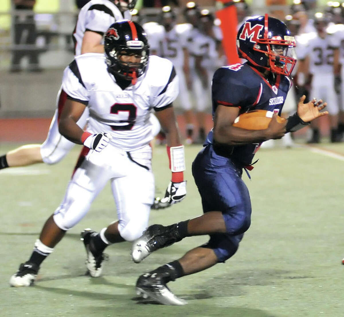 Hour photo/John Nash Brien McMahon's Trevon Forney races past a Fairfield Warde defender during last Friday's game. Forney scored three touchdowns -- all from long range -- in a breakout performance that will force opposing coaches to be aware of his presence.