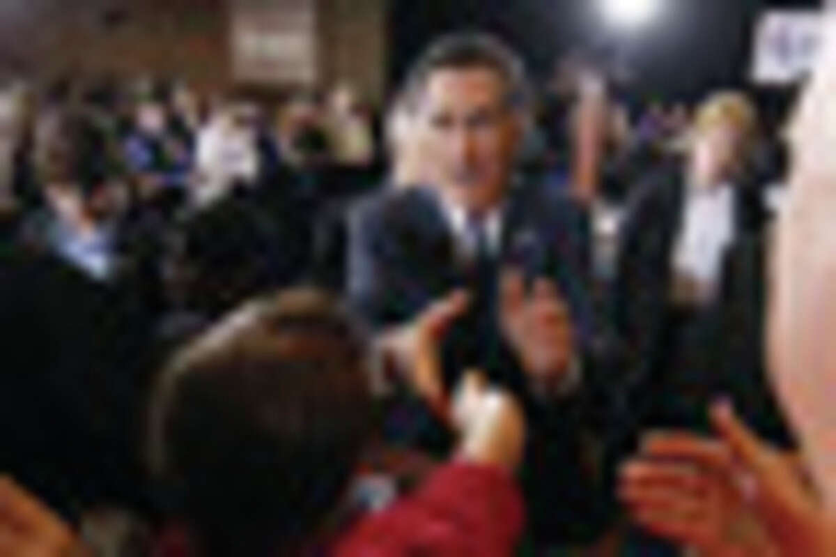 Republican presidential candidate, former Massachusetts Gov. Mitt Romney, greets supporters at his election watch party after winning the Michigan primary in Novi, Mich., Tuesday, Feb. 28, 2012. (AP Photo/Gerald Herbert)
