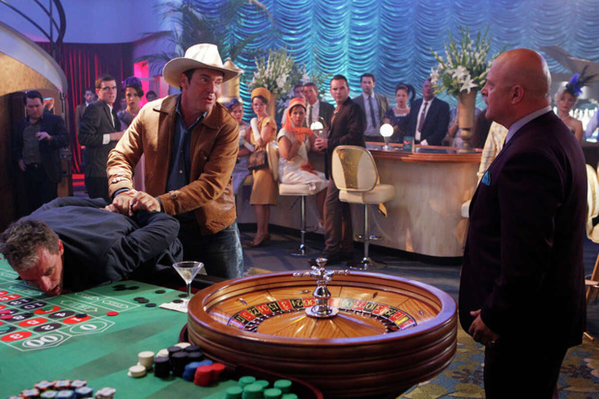 """This image released by CBS shows Dennis Quaid, left, and Michael Chiklis in a scene from the new CBS series, """"Vegas,"""" premiering Tuesday, Sept. 25, at 10 p.m. ET/PT. (AP Photo/CBS, Monty Brinton)"""