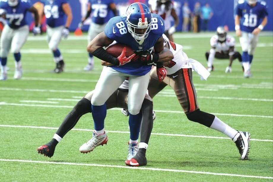 AP photoNew York Giants wide receiver Hakeem Nicks (88) breaks a tackle during the second half of Sunday's game against the Tampa Bay Buccaneers. Nicks is looking forward to playing the Carolina Panthers Thursday night in his home state. / FR59151 AP