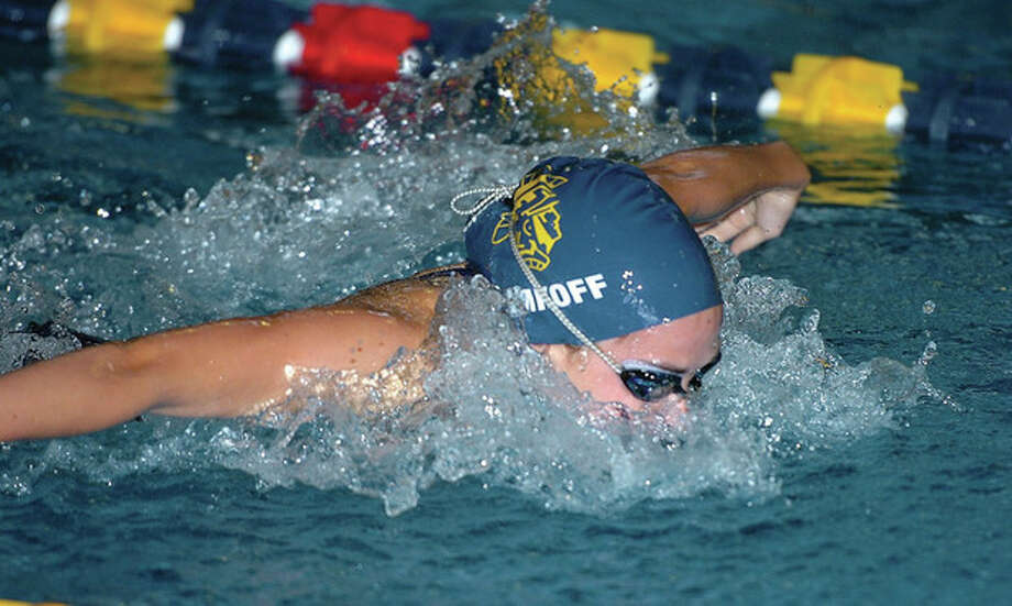 Hour photo/Alex von KleydorffWeston's Brenna Nimkoff competes in the 200 medley relay during Tuesday's meet against New Milford at the Weston pool. / 2012 The Hour Newspapers