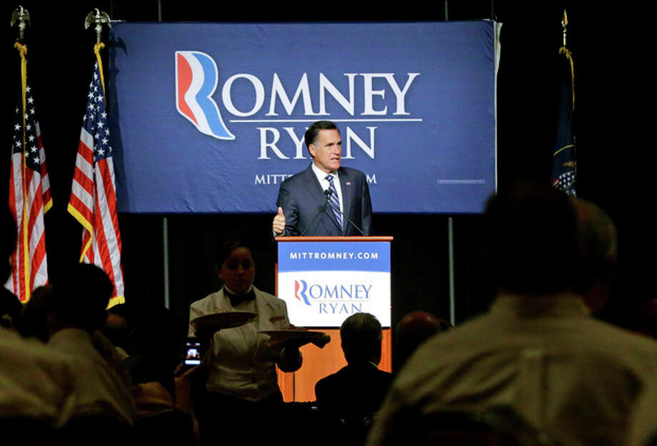 Lunch is served as Republican presidential candidate and former Massachusetts Gov. Mitt Romney speaks at a campaign fundraising event, the first of which reporters' cameras were allowed in, at The Grand America in Salt Lake City, Utah, Tuesday, Sept. 18, 2012. (AP Photo/Charles Dharapak) / AP