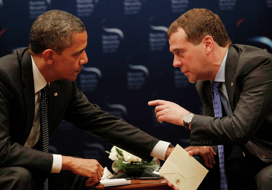 "FILE - In this March 26, 2012, file photo, President Barack Obama, left, chats with Russian President Dmitry Medvedev during a bilateral meeting at the Nuclear Security Summit in Seoul, South Korea. Mitt Romney's remarks disparaging 47 percent of Americans are the latest in a string of poorly chosen words that play into Democrats' portrayal of him as out of touch. But he's not the only one plagued by a campaign gaffe deemed elitist by critics. an open microphone caught Obama telling Russia's outgoing president that he needed space to work out their disagreements over U.S. missile defense plans. ""After my election, I have more flexibility,"" Obama quietly told Medvedev, who said he would carry that message home. Romney called it evidence that Obama is hiding a secret agenda for a second term. (AP Photo/Pablo Martinez Monsivais, File) / AP"