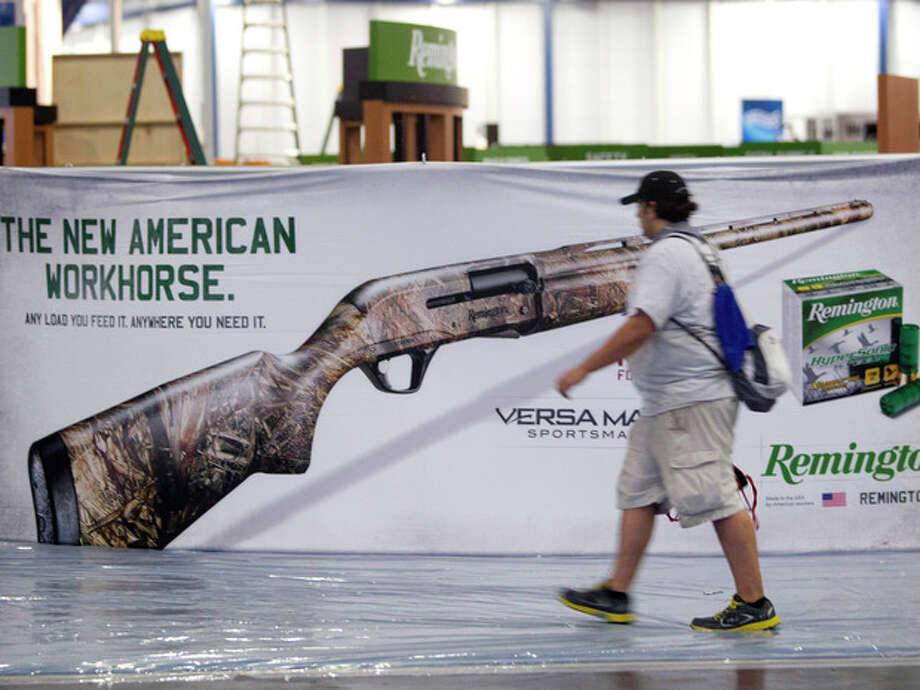 Exhibitors began setting up in preparation The National Rifle Association Annual Meetings on Wednesday, May 1, 2013, in Houston. The 2013 NRA Annual Meetings and Exhibits is scheduled to being Friday. (AP Photo/Houston Chronicle, Johnny Hanson) / Houston Chronicle
