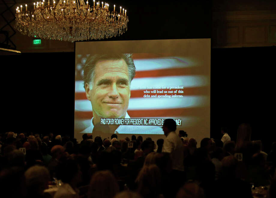 A campaign film is shown before Republican presidential candidate and former Massachusetts Gov. Mitt Romney speaks at a campaign fundraising event at The Grand America in Salt Lake City, Utah, Tuesday, Sept. 18, 2012. (AP Photo/Charles Dharapak) / AP