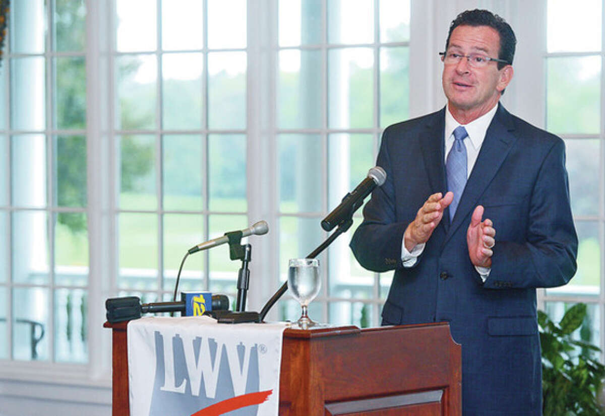 Hour photo / Erik Trautmann Gov. Dannel P. Malloy speaks at a meeting of the Darien League of Women Voters at the Country Club of Darien Tuesday addressing voter fraud laws.