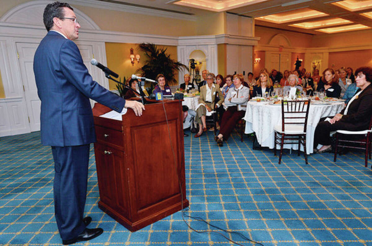 Governor Dannel P. Malloy speaks at a meeting of the Darien League of Women Voters at the Country Club of Darien Tuesday addressing voter fraud laws. Hour photo / Erik Trautmann