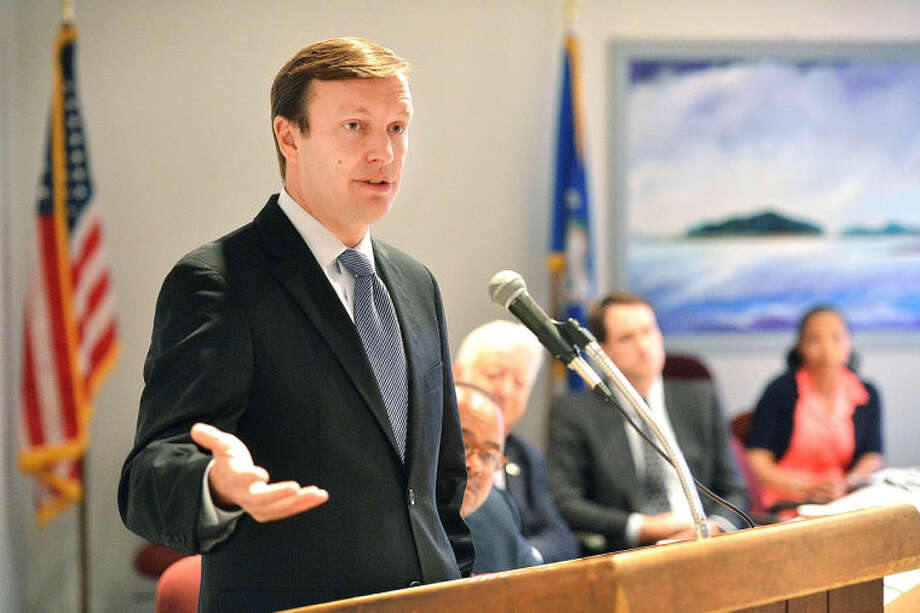 Hour Photo/Alex von Kleydorff . Senator Chris Murphy speaks during the Southern Connecticut Regional Housing Summit at Norwalk City Hall on Monday.