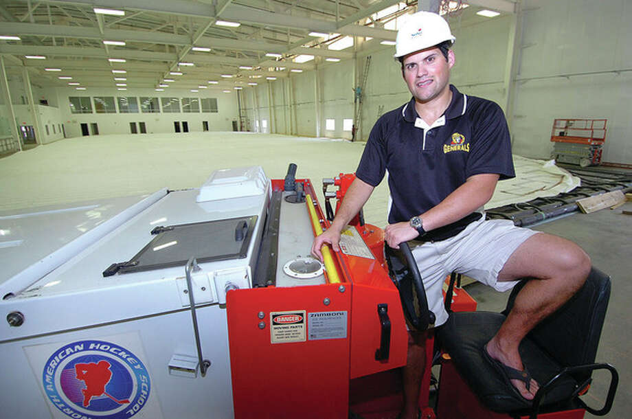Hour photo/Alex von KleydorffRyan Hughes, president of the new SoNo Ice House and the Connecticut Oilers Eastern Junior Hockey League team, tries out his new Zamboni, which arrived last week. A second Zamboni is expected to be delivered today, in plenty of time for next month's opening of the new facility on Wilson Avenue. / 2012 The Hour Newspapers