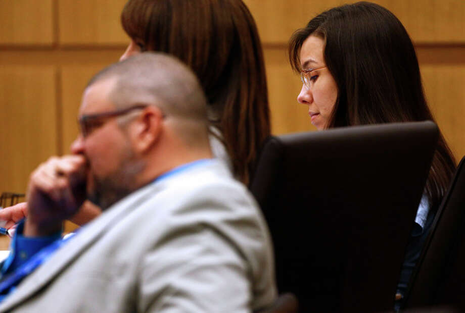 Defendant Jodi Arias listens to prosecutor Juan Martinez makes his closing arguments during her trial at Maricopa County Superior Court in Phoenix on Thursday, May 2, 2013. Arias is charged with first-degree murder in the stabbing and shooting death of Travis Alexander, 30, in his suburban Phoenix home in June 2008. (The Arizona Republic, Rob Schumacher, Pool) / The Arizona Republic, Pool