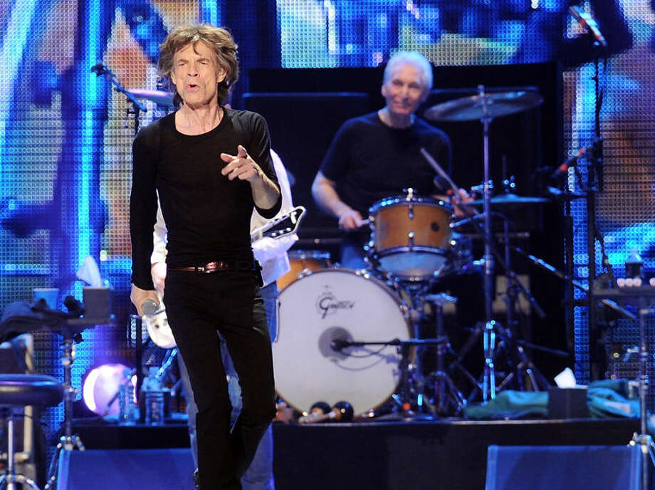 FILE - This Dec. 15, 2012 file photo shows lead singer Mick Jagger, left, and Charlie Watts of The Rolling Stones during a performance at the Prudential Center in Newark, N.J. Before they kick off their Ò50 and CountingÓ tour, the Rolling Stones are playing a warm-up date in a small club in Los Angeles. The band is due to play the Echoplex on Saturday night before a crowd that will be miniscule compared to the thousands who are set to see them perform May 3 at the Staples Center. (Photo by Evan Agostini/Invision/AP)