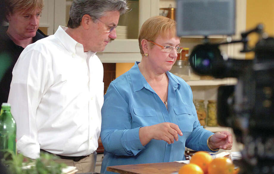 Hour Photo/Alex von Kleydorff Lidia Bastianich and Director/Produver John Parry during the taping of all the new episodes of her TV show at Clarke Kitchens showroom in South Norwalk on Tuesday. / 2013 The Hour Newspapers