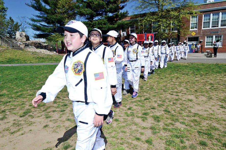 "Hour photo /Erik TrautmannPreparing to blast offColumbus Magnet School fifth-grader Marco Ceci and Payload Specialist in the school's ""Young Astronaut"" program get ready for their payload launch ceremony Friday inpreparation for school simulated space mission next week. / (C)2013, The Hour Newspapers, all rights reserved"