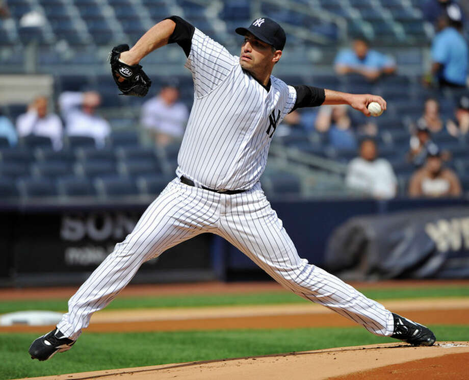 New York Yankees starter Andy Pettitte delivers a pitch to the Toronto Blue Jays during the first inning of the first baseball game of a doubleheader, Wednesday, Sept. 19, 2012, at Yankee Stadium in New York. (AP Photo/Bill Kostroun) / FR51951 AP