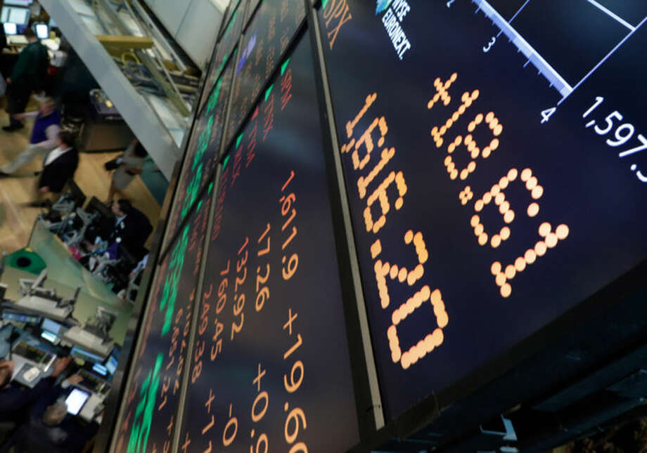 A board overlooking the floor of the New York Stock Exchange shows an intraday number above 1,600 for the S&P 500, Friday, May 3, 2013. A big gain in the job market is lifting the stock market to a record high. The Dow Jones industrial average crossed 15,000 for the first time, and the Standard and Poor's 500 index, a broader market measure, rose above 1,600.(AP Photo/Richard Drew)