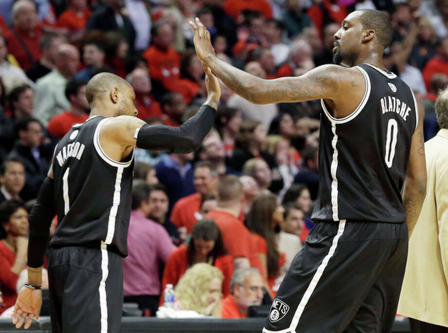 Brooklyn Nets forward Andray Blatche, right, celebrates with C.J. Watson during the second half in Game 6 of their first-round NBA basketball playoff series against the Chicago Bulls in Chicago, Thursday, May 2, 2013. The Nets won 95-92. (AP Photo/Nam Y. Huh) / AP