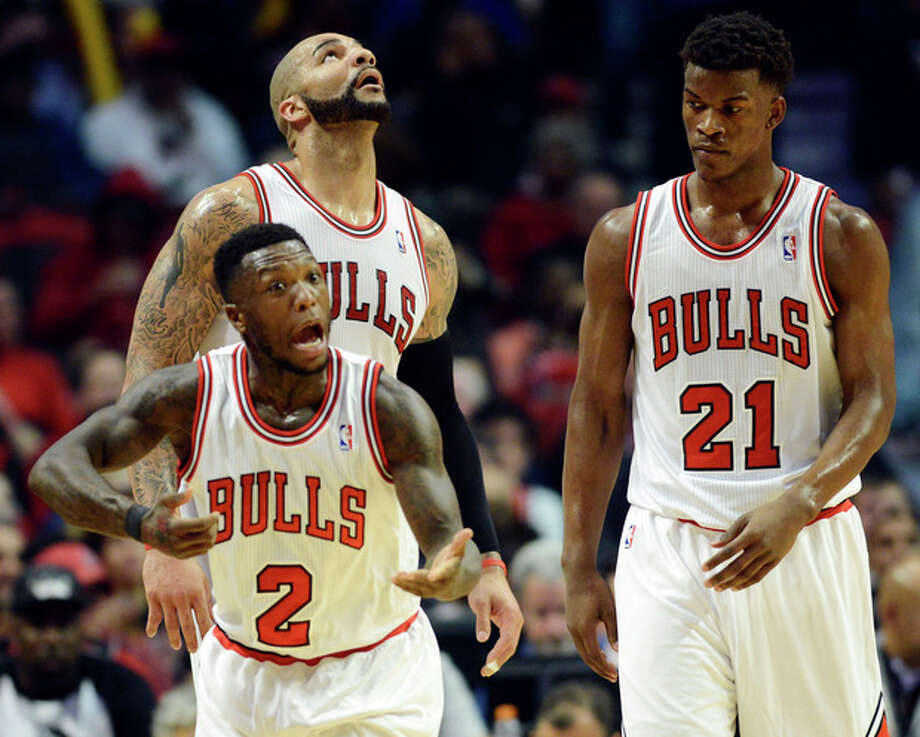 Chicago Bulls' Nate Robinson (2) reacts after drawing contact from a Brooklyn Nets player as Carlos Boozer, rear left, and Jimmy Butler look on during Game 6 of their first-round NBA basketball playoff series in Chicago, Thursday, May 2, 2013. The Nets won 95-92. (AP Photo/Daily Herald, Joe Lewnard) MANDATORY CREDIT; MAGS OUT; TV OUT / Daily Herald
