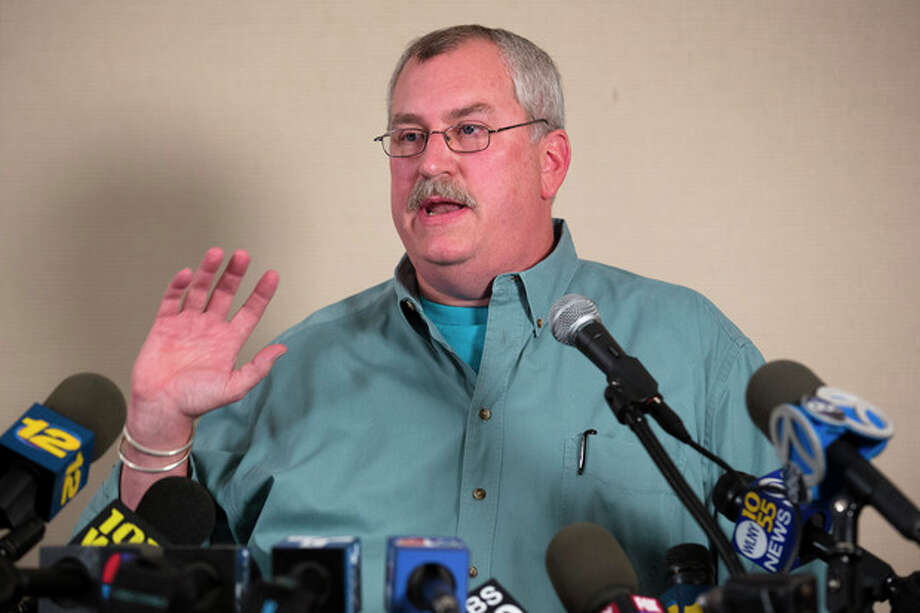 Bronx Zoo Director Jim Breheny speaks to the media during a news conference, Friday, Sept. 21, 2012, in New York. A visitor to the zoo was mauled by a tiger after he leaped from an elevated monorail train and plummeted over a fence into an exhibit, police and zoo officials said. (AP Photo/John Minchillo) / FR170537 AP