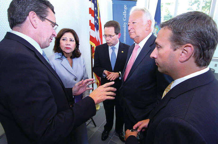 Hour photo / Alex von KleydorffGov. Dan Malloy, U.S. Labor Secretary Hilds Solis, Norwalk Community Collge President Dr. David Levinson, Norwalk Mayor Richard Moccia and state Sen. Bob Duff talk as they tour the new Center for Health Wellness and Science Friday in Norwalk. / 2012 The Hour Newspapers