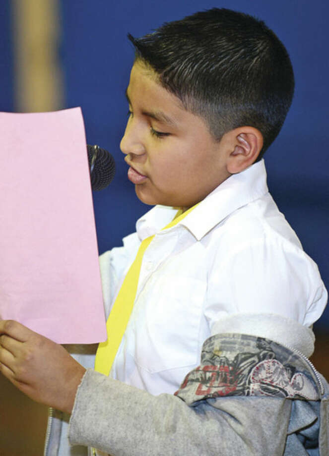 """@Cutline Byline:Hour photo /Erik TrautmannJonathan Gallegos reads his poem """"The Heart Break Kid"""" as Silvermine Elementary School fourth and fifth graders hold a poetry slam Friday."""