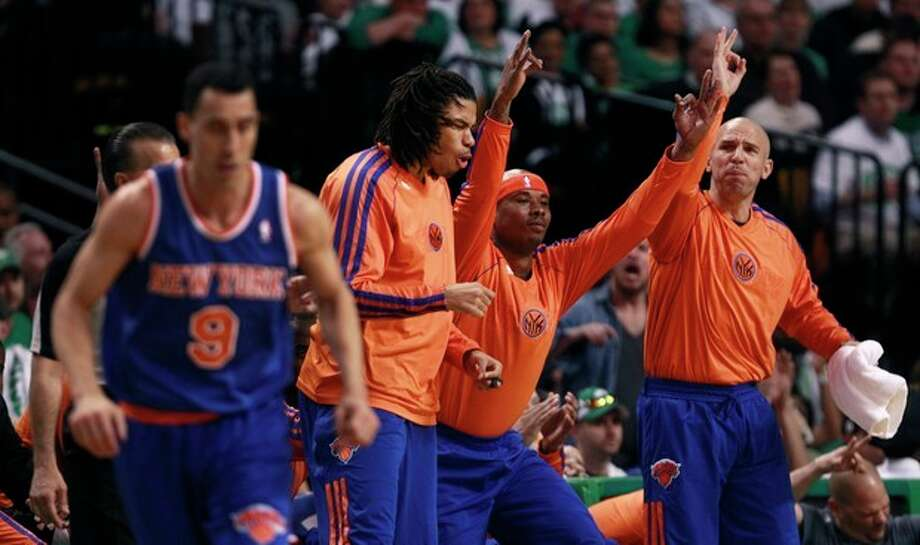 New York Knicks guard Jason Kidd, right, celebrates a three-point basket by teammate Pablo Prigioni during the first quarter against the Boston Celtics in Game 6 of their first-round NBA basketball playoff series in Boston, Friday, May 3, 2013. From left to right, are: Prigioni (9), Chris Copeland, Quentin Richardson and Kidd. (AP Photo/Charles Krupa) / AP