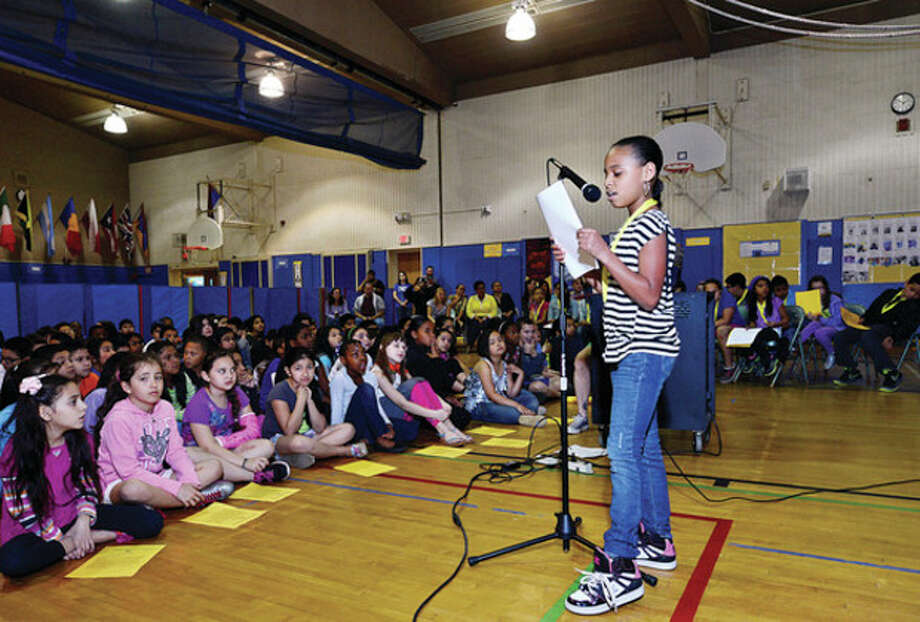 Serenity Saunders reads her poem The Pain of the Colored as Silvermine Elementary School fourth and fifth graders are hold a poetry slam Friday.Hour photo / Erik Trautmann / (C)2013, The Hour Newspapers, all rights reserved